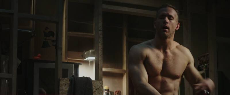 Shirtless Ryan Reynolds as Wade Wilson in Deadpool