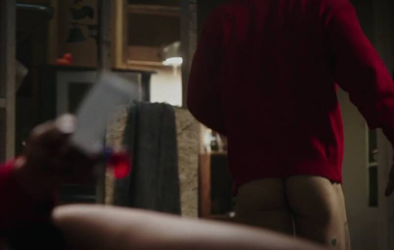 Ryan Reynolds shows his naked butt and some tattoos in a scene from Deadpool