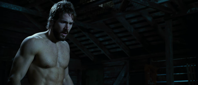 Actor Ryan Reynolds shirtless in The Amityville Horror movie