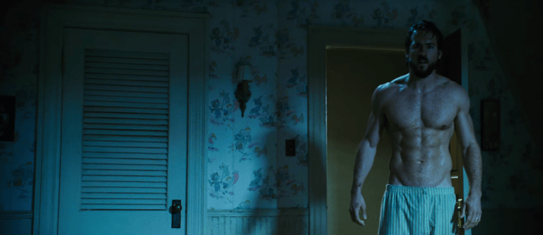 Hot American actor Ryan Reynolds shirtless in the bedroom