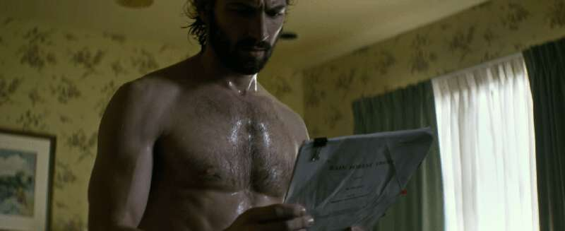 Shirtless actor Michiel Huisman in a towel
