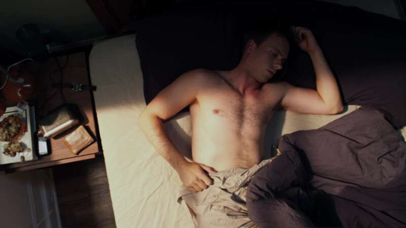 Sexy actor Patrick J. Adams wakes up in bed